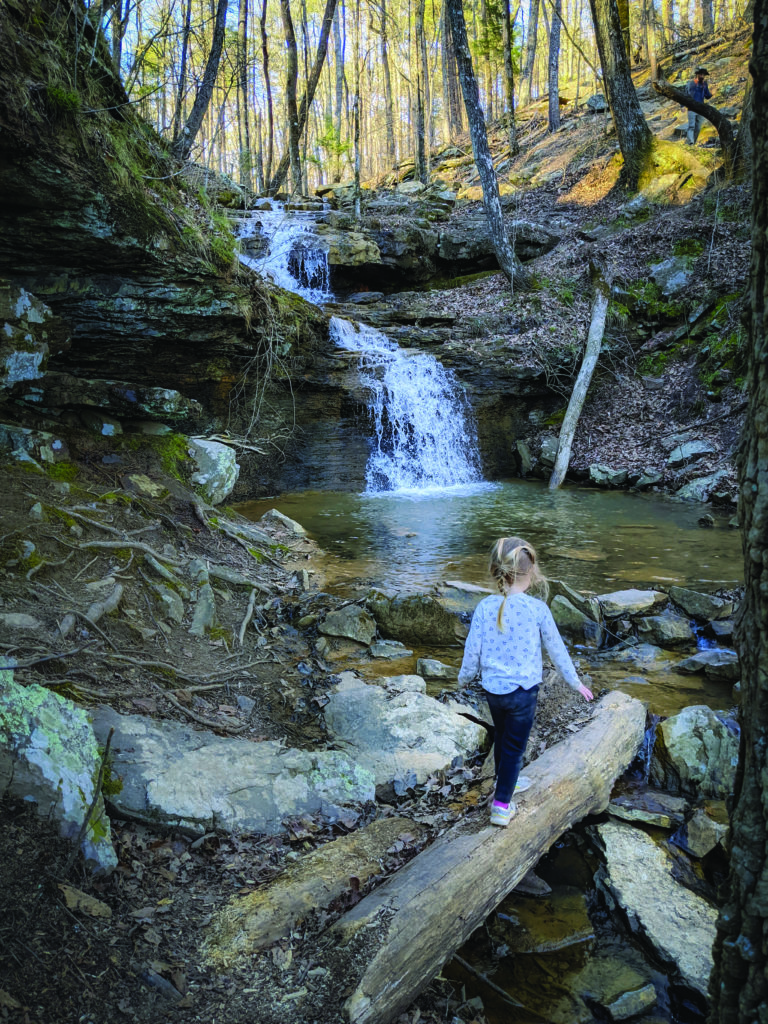 A young walker along the Alum Hollow Trail in Green Mountain Nature Preserve near Huntsville, part of the Land Trust of North Alabama. Photo by David Parham